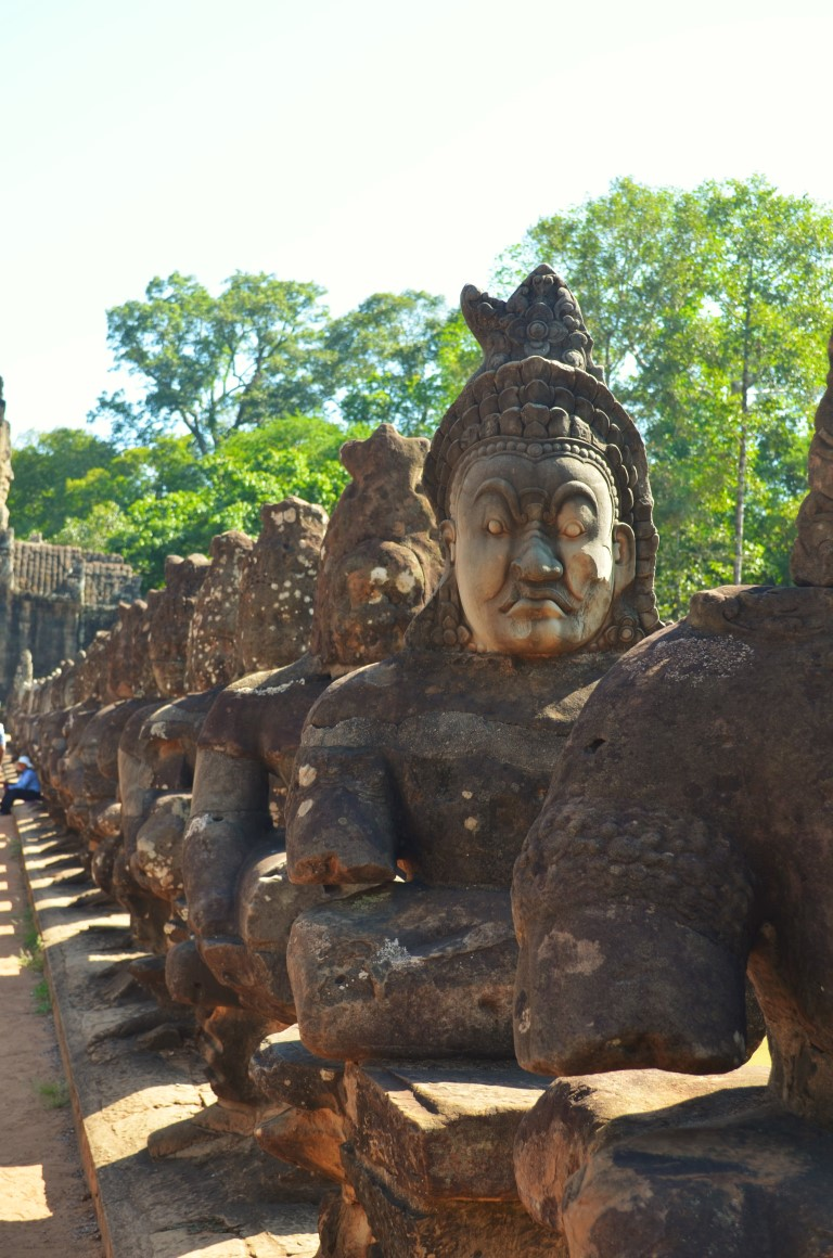 Statues of gods and demons depicting 'Sagarmanthan' at the south gate of Angkor Thom