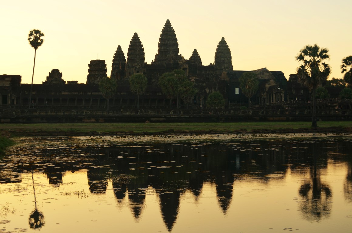 Angkor Wat at dawn. Arrive early to get yourself a nice spot by the reservoir to see the reflection of Angkor Wat as the sun comes up!